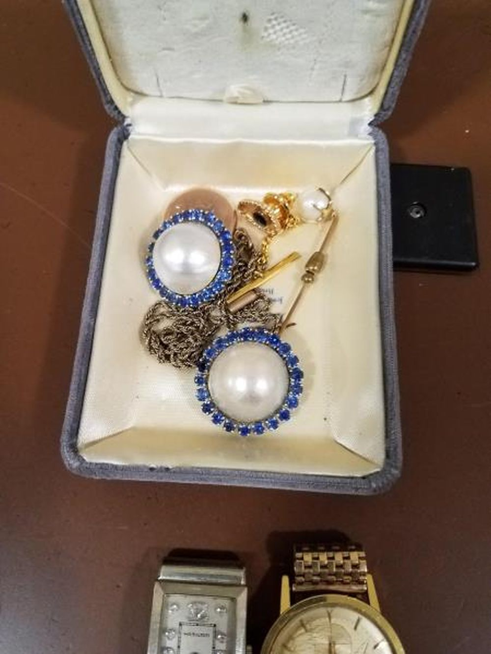 Clip On Earings w/ 21 Blue Saphire Stones Surrounding White Mother Of Pearl Center. (Just Earings Included In This Sale)