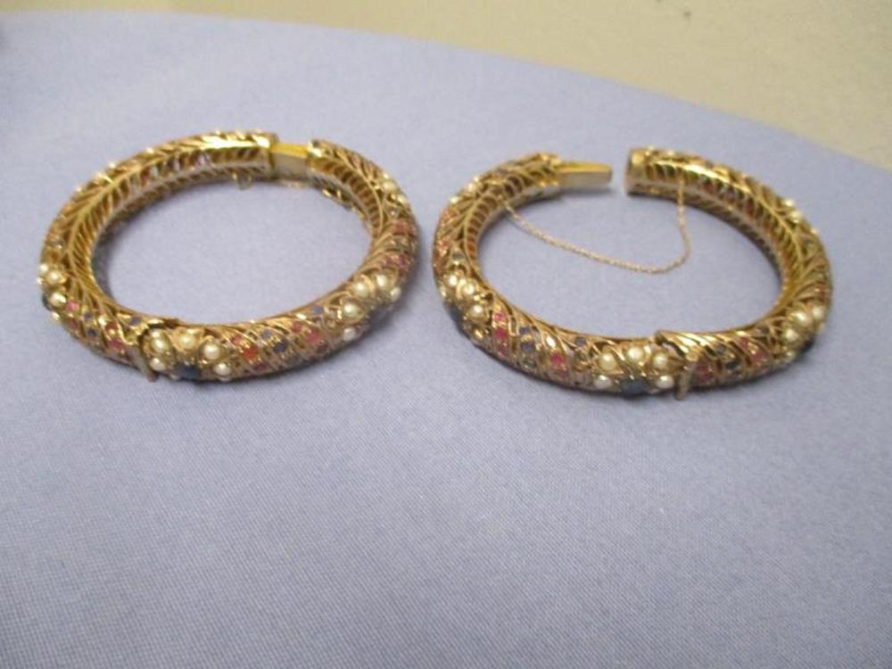 2 Matching Gold Bangles w/ Ruby, Sapphire & Pearls 46 Sapphires, 48 Pearls, 52 Rubies, One Safety Link Broke, Total Weight 106 Grams
