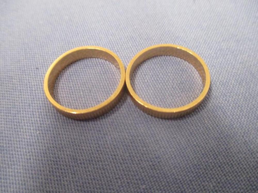 (2) Matching Gold Reeded Bands, 14 Karat Total Weights: 5.4 Grams