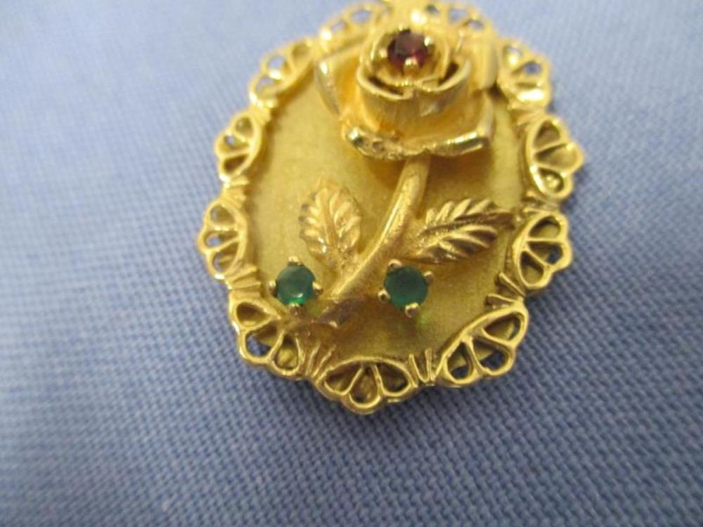 14 Karat Gold Charm, Oval w/ Rose & Two Green Stones & One Red Stone, Total Weight: 6 Grams