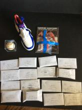 Table Top of Sports Memorabilia and Trading Card All Unclaimed or Unsold Past Auction Lots