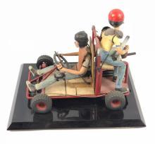 """Lot 78: """"Junk"""" - Wes Craven - Prop Go-Kart with Children Model"""