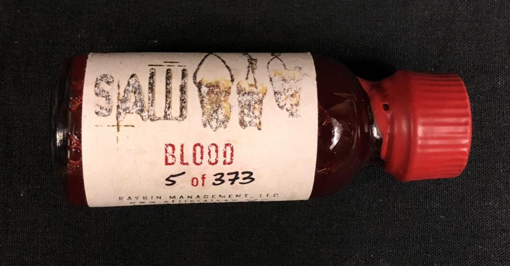 Lot 24: Saw III (2006) - Blood Vial - Signed by J. LaRose (Troy)