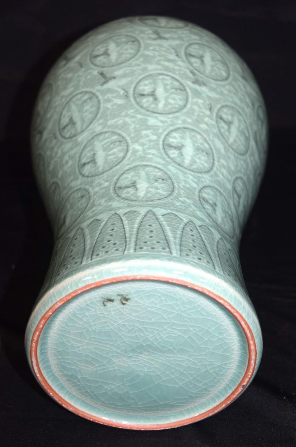 A Korean porcelain Meiping shape vase decorated with storks . 35cm.