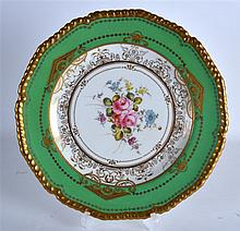 A FINE ROYAL CROWN DERBY PLATE in the manner of Albert Gregory. 9.25in