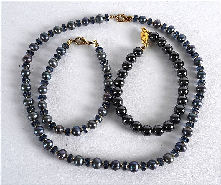 a black pearl necklace and matching bracelet 2