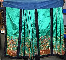 A LOVELY LATE 19TH/20TH CENTURY CHINSE GREEN SILKWORK SKIRT depicting