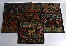 A GROUP OF SEVEN 19TH CENTURY CHINESE SILK BADGES of various designs.