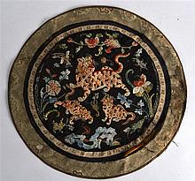 A CHINESE QING DYNASTY CIRCULAR SILK ROUNDEL depicting a tiger and cub