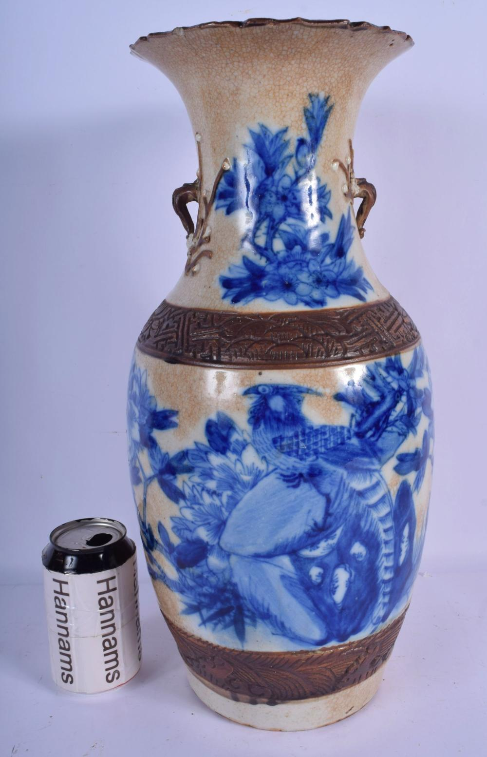 A LARGE 19TH CENTURY CHINESE CRACKLE GLAZED BLUE AND WHITE VASE Qing, painted with flowers. 44 cm x 16 cm.