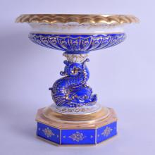 A GOOD 19TH CENTURY FRENCH PARIS PORCELAIN COMPORT painted with flowers under a rich blue ground. 22 cm x 19 cm.