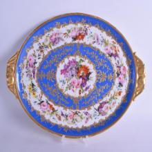 A GOOD 19TH CENTURY FRENCH PARIS PORCELAION OVAL TRAY painted with rich foliage upon a blue ground. 38 cm x 26 cm.