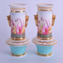 A PAIR OF EARLY 19TH CENTURY ENGLISH PORCELAIN VASES Coalport or Spode, painted with a band of foliage. 8.75 cm high.