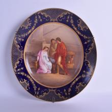 A LARGE 19TH CENTURY VIENNA PORCELAIN DISH painted with three classical figures within an interior. 31 cm diameter.
