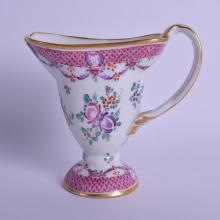 A 19TH CENTURY FRENCH SAMSONS OF PARIS PORCELAIN CREAM JUG Chinese export style, painted with flowers under a pink diaper border. 13 cm x 17 cm.