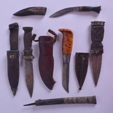A GROUP OF FIVE VINTAGE DAGGERS in various forms and sizes. Largest 23 cm long. (5)