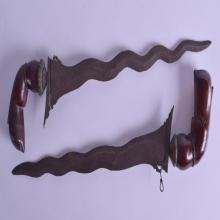 A PAIR OF 19TH CENTURY MIDDLE EASTERN KRISS DAGGERS with gnurled wood handles. 41 cm long.