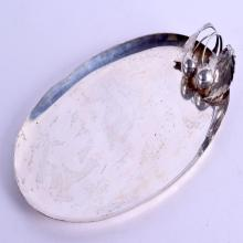 AN EARLY 20TH CENTURY STERLING SILVER OVAL DISH overlaid with a pair of cherries and leaves. 9.5 oz. 25 cm wide.