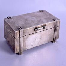 A STLYISH 1950S ENGLISH SILVER CIGARETTE BOX. Birmingham 1958. 17.5 oz inc wood liner. 16 cm x 9.5 cm.