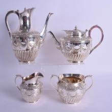 A STYLISH EDWARDIAN MAPPIN & WEBB SILVER PLATED TEASET decorated with neo classical swags and foliage. Largest 20 cm x 19 cm. (4)