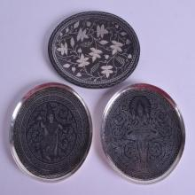 A PAIR OF SIAM SILVER NIELLO BUDDHISTIC DISHES together with a silver inlaid Middle Eastern dish. Silver 3.7 oz. (3)