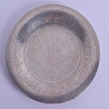 A LATE 19TH CENTURY MIDDLE EASTERN SILVER CIRCULAR DISH decorated with Kufic script and scrolling foliage. 15.5 oz. 27.5 cm diameter.