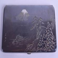 A LARGE LATE 19TH CENTURY JAPANESE MEIJI PERIOD SILVER CIGARETTE CASE engraved with landscapes and Mount Fuji. 150 grams. 16 cm wide.