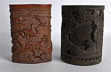 A CHINESE CYLINDRICAL BRONZE BRUSH POT decorated with figures within landsc