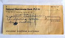A ROBERT MITCHUM AUTOGRAPH contained on a cheque.