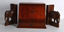 AN EARLY 20TH CENTURY MAHOGANY TWO DOOR CABINET together with a pair of car