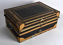 A VICTORIAN TOLEWARE DEEDS BOX with painted gilt decoration. 1ft 5ins wide.