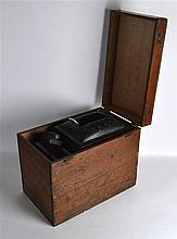 A VICTORIAN BOXED MAGIC LANTERN. 1ft 5ins wide.
