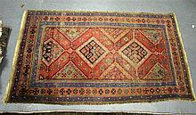 A RED GROUND RUG. 5ft 9ins x 3ft 4ins