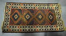 A RED GROUND RUG with beige motifs. 5ft 1ins x 2ft 9ins