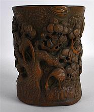 A CHINESE CARVED BAMBOO BRUSH POT 20th Century, of naturalistic form, decor