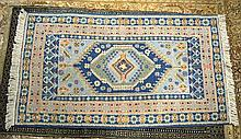 A BLUE GROUND RUG decorated with flowers. 5ft x 2ft 6ins