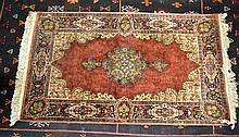A RED GROUND PERSIAN RUG. 4ft 3ins x 2ft 5ins