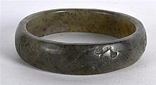 A CHINESE CARVED MUTTON JADE CIRCULAR BANGLE carved with bats. 3Ins diamete