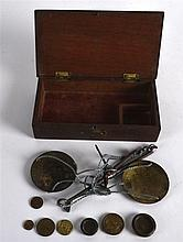 A CASED PAIR OF EDWARDIAN SCALES.