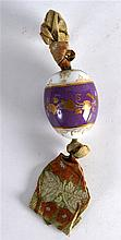 A RUSSIAN PUCE PORCELAIN EASTER EGG painted with gilt acorn leaves upon a c