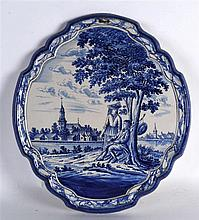 A LARGE LATE 19TH CENTURY FRENCH FAIENCE BLUE AND WHITE DELft STYLE PLAQUE