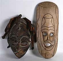 A WEST AFRICAN CHOKWE CARVED WOOD MASK together with another lightwood shal