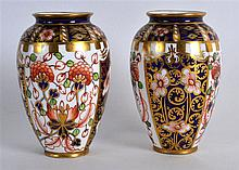 ROYAL CROWN DERBY FINE PAIR OF MINIATURE AMPHORA VASES painted with Imari p