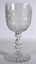 A GOOD EDWARDIAN ENGRAVED CLEAR GLASS GOBLET etched with a central bird amo