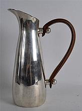 A STYLISH SILVER PLATED ART DECO PITCHER with leather handle. 10.75ins high