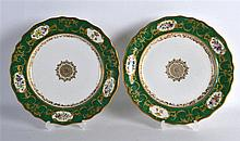 19TH C. FRENCH PORCELAIN PAIR OF PLATES painted with flowers in oval panel