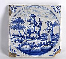 AN 18TH CENTURY DUTCH DELft BLUE AND WHITE TILE painted with a figure upon