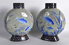 A PAIR OF LATE VICTORIAN OPALINE GLASS VASES painted with various fish swim