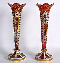 A PAIR OF 19TH CENTURY BOHEMIAN RUBY AND WHITE ENAMEL OVERLAID VASES painte