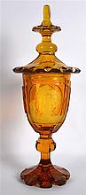 A RARE 19TH CENTURY BOHEMIAN AMBER GLASS VASE AND COVER engraved with a sce